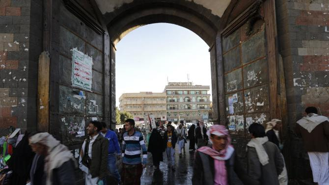 People walk through the gate of Bab al-Yemen in the old quarter of Sanaa
