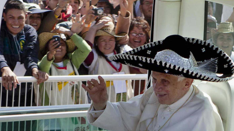 FILE - In this Sunday, March 25, 2012 file photo, Pope Benedict XVI waves from the popemobile wearing a Mexican sombrero as he arrives to give a Mass in Bicentennial Park near Silao, Mexico. Pope Benedict XVI announced Monday, Feb. 11, 2013, he would resign Feb. 28 because he is simply too old to carry on. (AP Photo/Eduardo Verdugo, File)