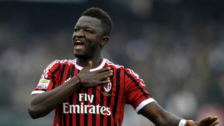 AC Milan's Sulley Muntari of Ghana celebrates after scoring a goal during a Serie A soccer match against Cesena, at Cesena's Manuzzi stadium, Italy, Sunday, Feb. 19, 2012. (AP Photo/Marco Vasini)