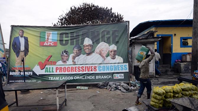 A man walks past a billboard of the main opposition All Progressives Congress (APC) presidential candidate Mohammadu Buhari in Lagos, on March 31, 2015