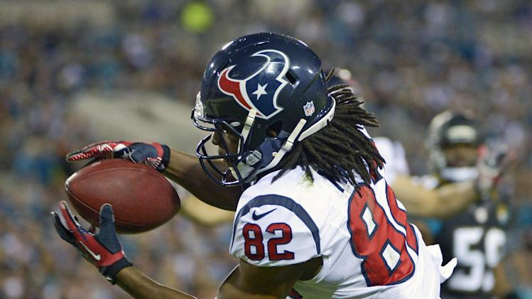 Houston Texans wide receiver Keshawn Martin catches an 8-yard pass for a touchdown against the Jacksonville Jaguars during the first half of an NFL football game in Jacksonville, Fla., Thursday, Dec. 5, 2013.(AP Photo/Phelan M. Ebenhack)