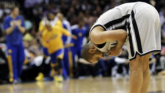 San Antonio Spurs' Tony Parker (9), of France, catches his breath during the second half in Game 2 of their Western Conference semifinal NBA basketball playoff series against the Golden State Warriors, Wednesday, May 8, 2013, in San Antonio. (AP Photo/Eric Gay)