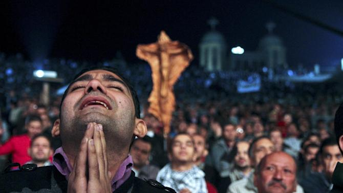 In this Thursday, Dec. 13, 2012 photo, Egyptian Christians gather for a prayer rally ahead of the constitutional referendum at Samaan el-Kharaz church in Cairo, Egypt. Egypt's churches called on Christians to gather and hold prayers for Egypt from 9:00 pm local time until midnight at the church in the city's Mokattam district. (AP Photo/Roger Anis, El Shorouk) EGYPT OUT