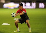 "Manchester United star Shinji Kagawa, seen here in July 2012, has vowed to take better care of himself after being sidelined by a back injury that he said may have been caused by ""travel and fatigue"""