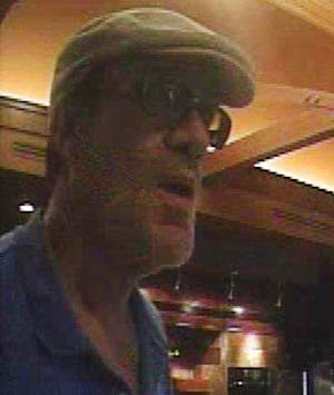 This image from a surveillance camera, released by the Williston (ND) Police Department shows Kent Clemens after he allegedly robbed Gate City Bank, in Williston, ND on July 18, 2012. Authorities say Clemens called 911 in Topeka, Kan., three days later telling officers that he had made a mistake and to arrest him. (AP Photo/ Williston Police Department)