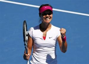 Li Na of China celebrates defeating Lucie Safarova of the Czech Republic during their women's singles match at the Australian Open 2014 tennis tournament in Melbourne
