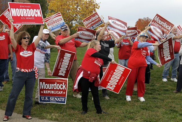 Supporters of Republican Richard Mourdock, candidate for Indiana's U.S. Senate seat, cheer outside the site of a debate between Mourdock, Democrat Joe Donnelly  and Libertarian Andrew Horning in New A