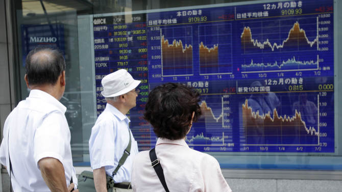 People watch the electric stock index display of a securities firm in Tokyo Wednesday, July 4, 2012. Asian stock markets were boosted Wednesday by hopes European central bankers will buoy economic growth with new stimulus measures. Japan's Nikkei 225 index rose 0.5 percent to 9,111.66. (AP Photo/Shizuo Kambayashi)