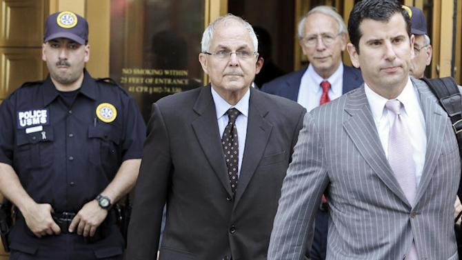 Peter Madoff, second from left, leaves Federal Court on Friday, June 29, 2012 in New York after pleading guilty to criminal charges. Peter Madoff, the younger brother and business partner of disgraced financier Bernard Madoff pleaded guilty Friday to charges he doctored documents, but insisted he knew nothing about his brother's historic Ponzi scheme. Madoff, 66, entered the plea in a deal that permits him to remain free on $5 million bail pending his Oct. 4 sentencing.  (AP Photo/Bebeto Matthews)