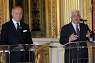 "<p>French Foreign Affairs Minister Laurent Fabius (L) and Palestinian President Mahmud Abbas (R) address journalists after signing a convention for financial aid to Palestine in June 2012 in Paris. The Palestinian Authority in the West Bank faces a $400 million budget shortfall and risks ""social upheaval,"" the World Bank and the International Monetary Fund warned on Wednesday.</p>"