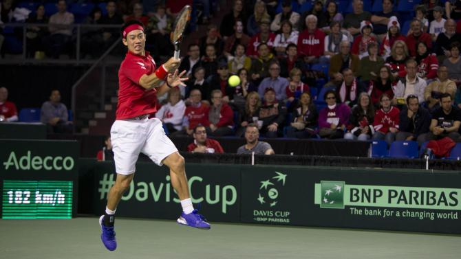 Japan's Nishikori hits a return to Canada's Pospisil during their Davis Cup tennis match at the Doug Mitchell Thunderbird Sports Centre in Vancouver