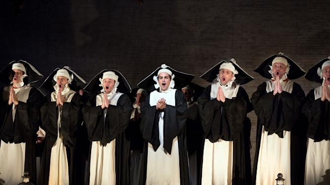 "In this Jan. 14, 2013 photo provided by the Metropolitan Opera, Juan Diego Florez, center, performs in the role of Count Ory during a dress rehearsal of Rossini's ""Le Comte Ory,"" at the Metropolitan Opera in New York. (AP Photo/Metropolitan Opera, Marty Sohl)"