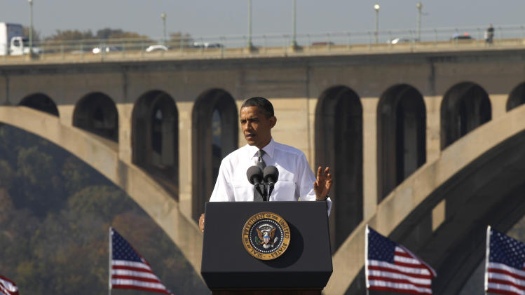 President Barack Obama speaks in front of the Key Bridge, which spans Arlington, Va. and Washington, Wednesday, Nov. 2, 2011, urging Congress to pass the infrastructure piece of the American Jobs Act. (AP Photo/Pablo Martinez Monsivais)