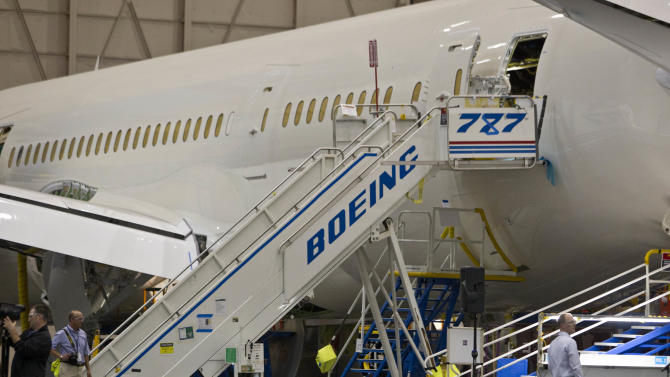 A makeshift sign converting 777 to 787 is placed on a Boeing Co. 787 prior to the delivery of the first to All Nippon Airways (ANA) at the assembly plant in Everett, Wash. on Sunday, Sept. 25, 2011. (AP Photo/John Froschauer)