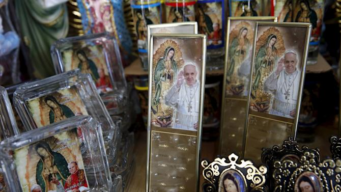 Images of Pope Francis and Virgin of Guadalupe are seen at a store, near the Basilica of Guadalupe, ahead of the upcoming visit of Pope Francis to Mexico City