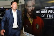 Belgium's new head coach Marc Wilmots passes by a Euro 2012 poster as he arrives for a press conference to present him as the new head coach of the Belgian national football team The Red Devils, at the KBVB-URBSFA headquarters in Brussels