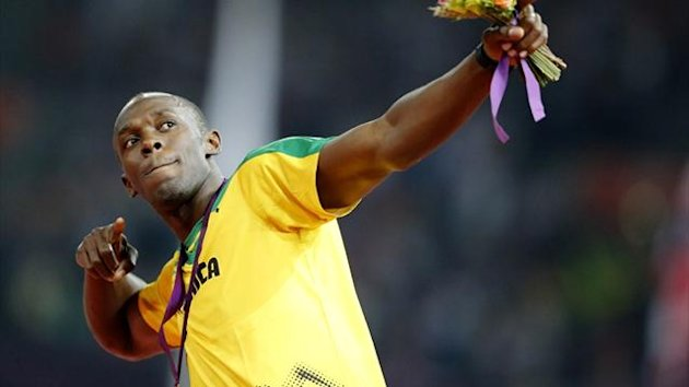 Jamaica's Usain Bolt celebrates with his gold medal during the presentation ceremony for the men's 200m (Reuters)