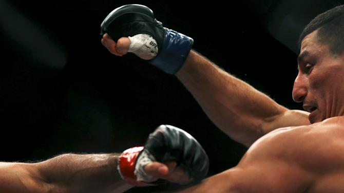 Taleb of France fights with Alves of Brazil during their UFC match in Rio de Janeiro