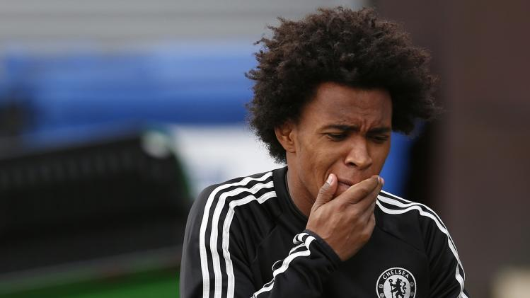 Chelsea's Willian arrives for a team training session at their training ground in Cobham, southern England