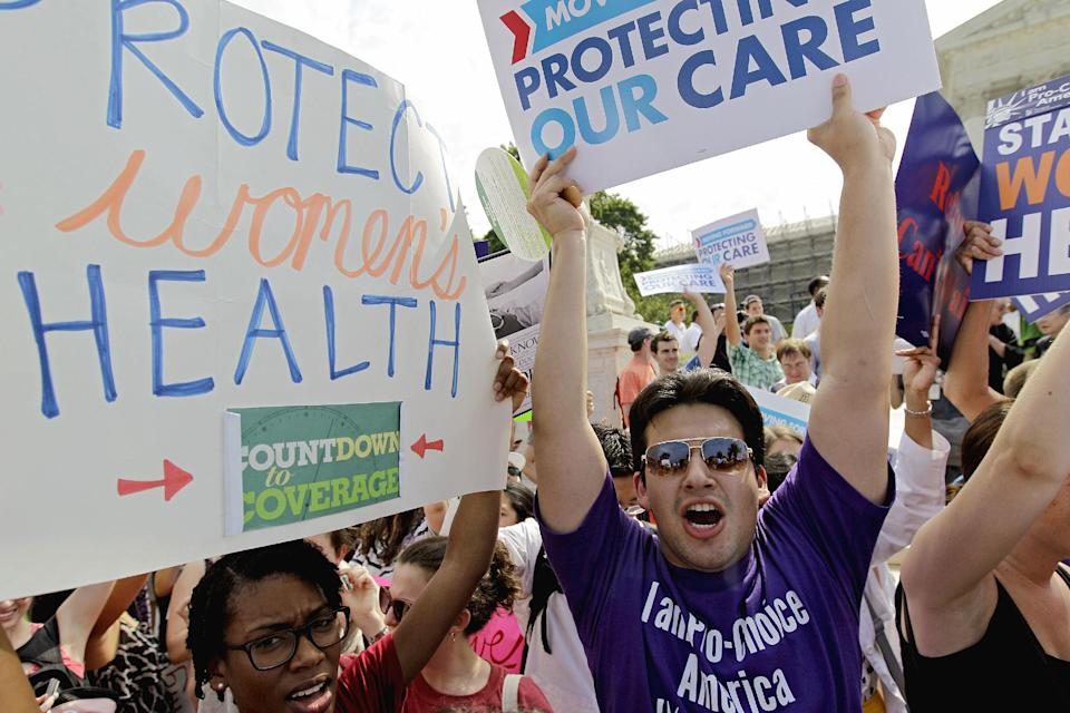Supporters of President Barack Obama's health care law celebrate outside the Supreme Court in Washington, Thursday, June 28, 2012, after the court's ruling was announced. AP Photo/David Goldman)