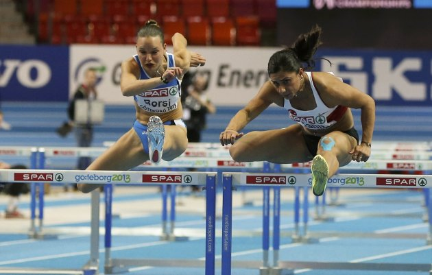 Yanit of Turkey competes to win next to Borsi of Italy in the 60m Hurdles Women Final at the European Athletics Indoor Championships in Gothenburg