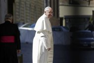 Pope Francis I leaves after a general audience in the Paul VI hall for members of the media at the Vatican March 16, 2013. REUTERS/Max Rossi