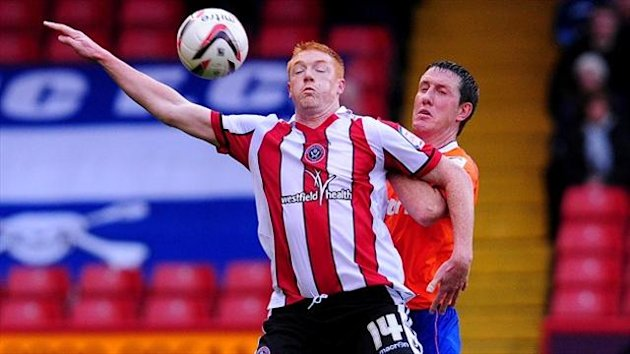 Dave Kitson has signed a two-year deal with Oxford following his release from Sheffield United