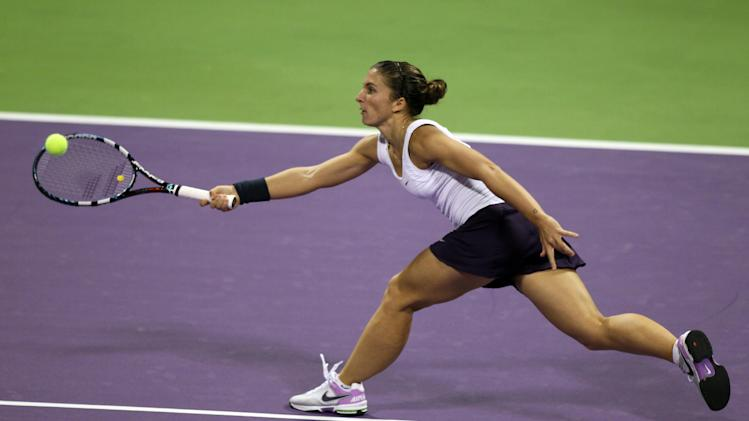 Sara Errani of Italy returns the ball to Victoria Azarenka of Belarus in the quarterfinal of the WTA Qatar Ladies Open tennis tournament in Doha, Qatar, Friday, Feb. 15, 2013. (AP Photo/Osama Faisal)