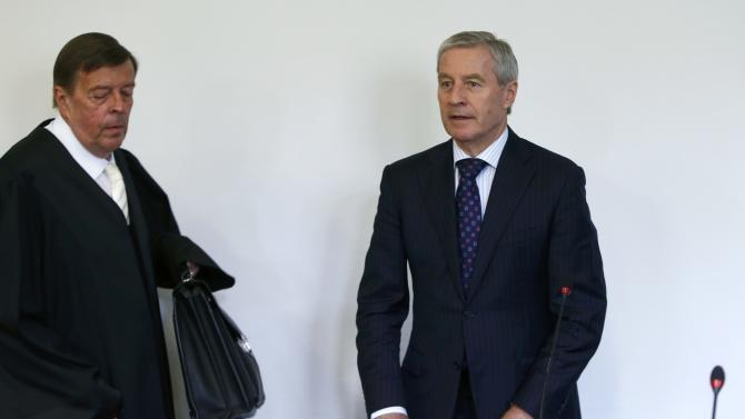 Fitschen, co-CEO of Deutsche Bank and lawyer Feigen arrive in courtroom in Munich