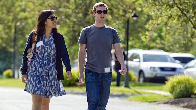FILE- In this July 9, 2011, file photo, Mark Zuckerberg, president and CEO of Facebook, walks to morning sessions with his girlfriend Priscilla Chan during the 2011 Allen and Co. Sun Valley Conference, in Sun Valley, Idaho.  On Saturday, May, 19, 2012,  Zuckerberg and Chan tied the knot at a small ceremony at his Palo Alto, Calif., home, capping a busy week for the couple (AP Photo/Julie Jacobson)