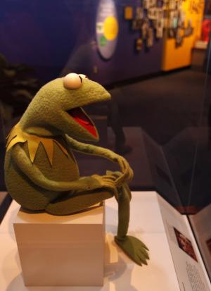 "A Kermit the Frog puppet is seen on display as part of a new exhibit,  ""American Stories,"" at the Smithsonian National Museum of American History in Washington, Wednesday, April 11, 2012. The National Museum of American History will open a new exhibit featuring iconic objects from pop culture along with objects dating back to the Pilgrims' arrival in 1620. ""American Stories"" will be a new chronology of U.S. history from the first encounters of Europeans and Native Americans to the 2008 presidential election. (AP Photo/Jacquelyn Martin)"