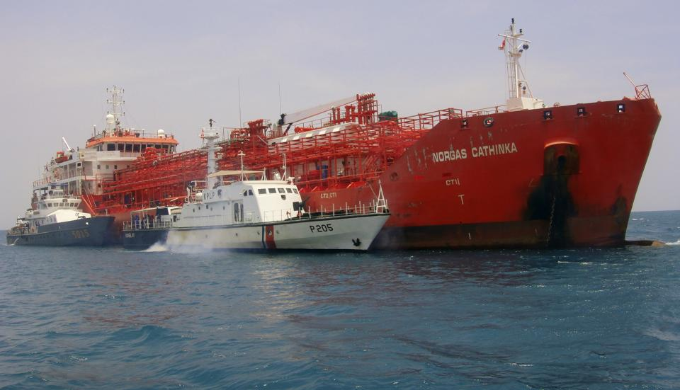 South-African flagged tanker Norgas Cathinka is escorted by Indonesian police and custom boats near Bakauheni port in Lampung province, Wednesday, Sept. 26, 2012. The tanker collided with a passenger ferry early Wednesday morning, killing at least eight people, officials said. (AP Photo)