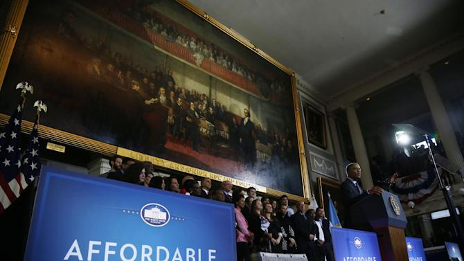 President Barack Obama speaks at Boston's historic Faneuil Hall about the federal health care law, Wednesday, Oct. 30, 2013. Faneuil Hall is where former Massachusetts Gov. Mitt Romney, Obama's rival in the 2012 presidential election, signed the state's landmark health care law in 2006, with top Democrats standing by his side. (AP Photo/Charles Dharapak)