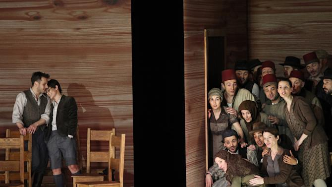 """In this April 15, 2013 photo provided by the Brooklyn Academy of Music countertenor Pascal Charbonneau, left, performs the role of David opposite soprano Ana Quintans, in the role of Jonathas as the rest of the cast gathers at the right during a final dress rehearsal of Charpentier's opera """"David et Jonathas,"""" at the Brooklyn Academy of Music, in New York. (AP Photo/Brooklyn Academy of Music, Julieta Cervantes) BAM Howard Gilman Opera House April 15, 2013 Photo Credit: Julieta Cervantes"""