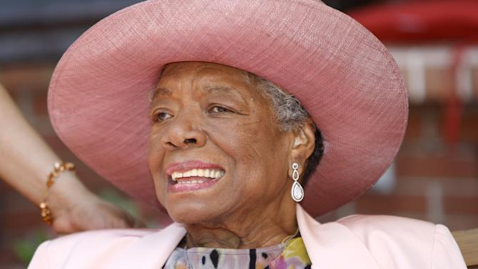 "FILE - In this May 20, 2010 file photo, Maya Angelou smiles as she greets guests at a garden party at her home in Winston-Salem, N.C. TV host and author Tavis Smiley and director Kenny Leon are developing a play based on Smiley's new book about his long friendship with Maya Angelou, ""My Journey With Maya."" (AP Photo/Nell Redmond, File)"