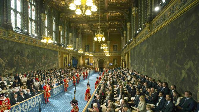 Guests sit in the Royal Gallery before the State Opening of Parliament in the House of Lords, at the Palace of Westminster in London
