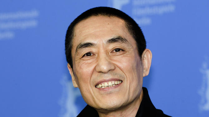 "FILE - In this Feb. 13, 2012 file photo, Chinese director Zhang Yimou poses during a photo call for his film ""The Flowers of War"" at the 62nd edition of the Berlinale, International Film Festival in Berlin. Zhang has admitted flouting his country's strict family planning rules by having three children with his wife, but rejected rumors that he had fathered seven children with several women. Zhang's office issued an open letter through its verified microblog account on the Twitter-like Sina Weibo site saying the director and his wife, Chen Ting, have two sons and a daughter. (AP Photo/Markus Schreiber, File)"