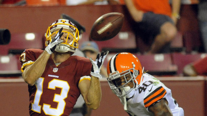 Washington Redskins wide receiver Nick Williams (13) catches a touchdown pass in front of Cleveland Browns defensive back Royce Adams (40) during the second half of an NFL preseason football game Monday, Aug. 18, 2014, in Landover, Md
