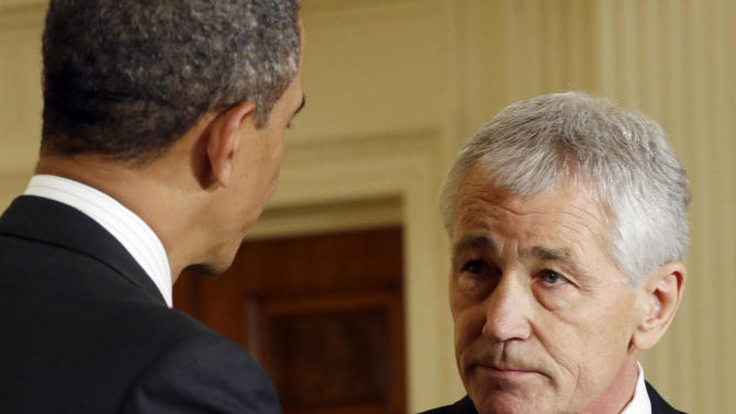 FILE - In this Jan. 7, 2013 file photo, President Barack Obama, left, shakes hands with his choice for Defense Secretary, former Nebraska Sen. Chuck Hagel, after announcing Hagel's nomination in the East Room of the White House in Washington. Hagel secured the backing of Sens. Chuck Schumer of New York and Barbara Boxer of California, two of the staunchest pro-Israel Senate Democrats, in a clear boost to the Republican's prospects of becoming President Barack Obama's next defense secretary. (AP Photo/Pablo Martinez Monsivais, File)
