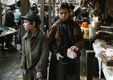 Barney Clark as Oliver and Harry Eden as Dodger in Columbia Pictures' Oliver Twist