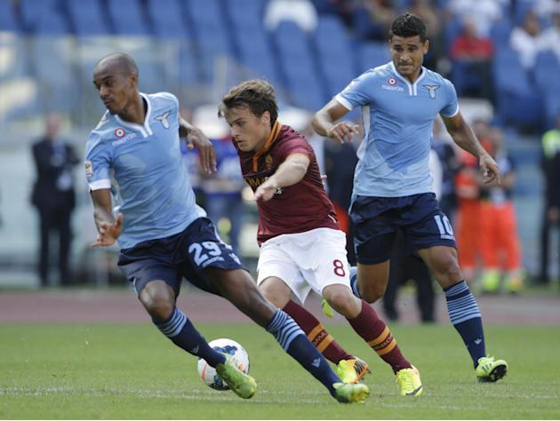AS Roma forward Adem Ljajic of Serbia, center, dribbles past Lazio defender Abdoulay Konko of France, left, and Lazio midfielder Ederson of Brazil during a Serie A soccer match at Rome's Olympic stadi