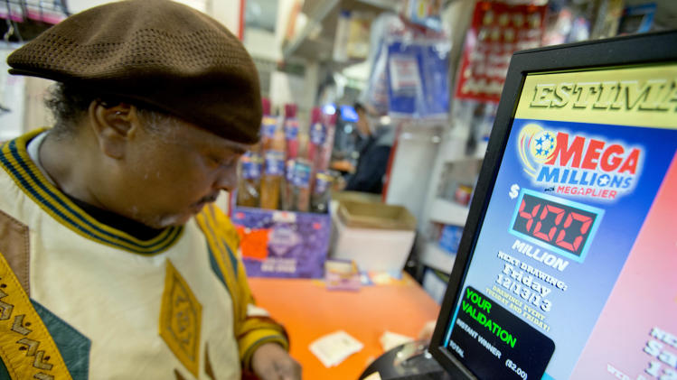 Charles Platt, of Atlanta, buys a Mega Millions lottery ticket at a convenience store, Thursday, Dec. 12, 2013, in Atlanta. The estimated jackpot of $400 million for Friday's Mega Millions is the fifth largest ever and second largest in the game's history, trailing behind the $656 million Mega Millions jackpot in 2012. Officials say the revamped game helped create the latest jackpot, and they expect more to come in 2014. (AP Photo/David Goldman)