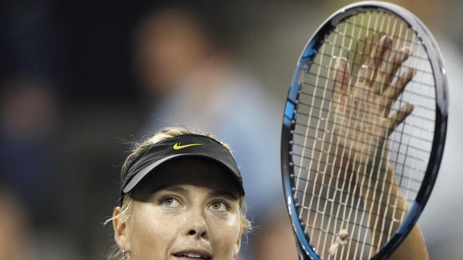 Maria Sharapova, of Russia, thanks the crowd after beating Anastasiya Yakimova, of Belarus, during the U.S. Open tennis tournament in New York, early morning Thursday, Sept. 1, 2011. Sharapova won 6-1, 6-1. (AP Photo/Charles Krupa)
