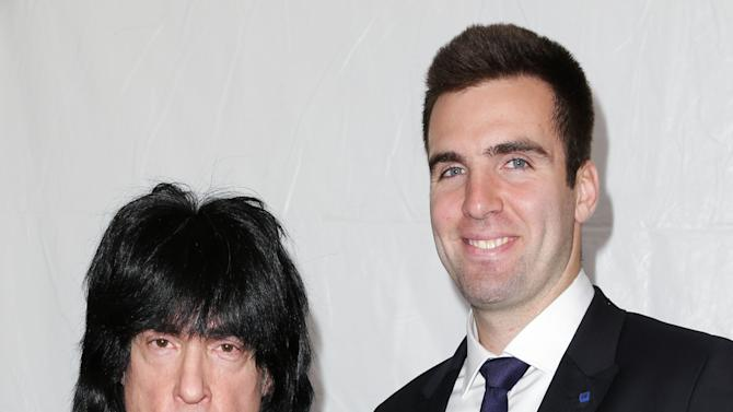 This image released by Starpix shows Ramones drummer Marky Ramone, left, and Baltimore Ravens quarterback Joe Flacco at the Tommy Hilfiger Men's Fall 2013 collection, Friday, Feb. 8, 2013 during Fashion Week in New York. (AP Photo/Starpix, Andrew Toth)