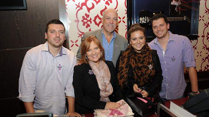 (Left to right) Christopher Manzo, Caroline Manzo, Albert Manzo, Lauren Manzo, and Albie Manzo work in the Hard Rock Cafe Rock Shop in support of the 13th Annual Pinktober Breast Cancer Awareness Campaign, on Tuesday, Oct. 2, 2012 at Hard Rock Cafe, New York. (Photo by Scott Gries/Invision for Hard Rock/AP Images)
