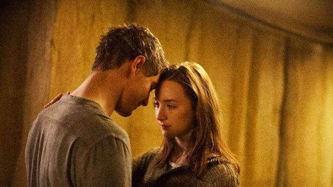 """This film image released by Open Road Films shows Max Irons, left, and Saoirse Ronan in a scene from """"The Host."""" (AP Photo/Open Road Films, Alan Markfield)"""