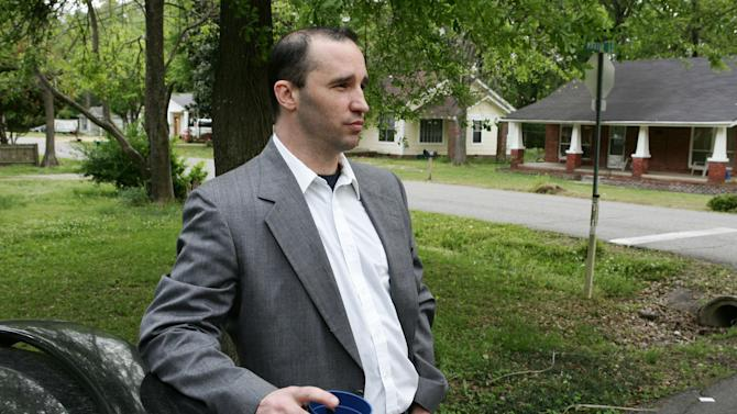FILE - In this Tuesday April 23, 2013 file photo, Everett Dutschke stands in the street near his home in Tupelo, Miss., and waits for the FBI to arrive and search his home in connection with the sending of poisoned letters to President Barack Obama and others. FBI spokeswoman Deborah Madden says Dutschke, 41, was arrested Saturday, April 27, 2013, at his Tupelo home in connection with the letters, which allegedly contained ricin. They were sent last week to Obama, Sen. Roger Wicker of Mississippi and earlier to 80-year-old Mississippi Judge Sadie Holland. (AP Photo/Northeast Mississippi Daily Journal, Thomas Wells, File) MANDATORY CREDIT