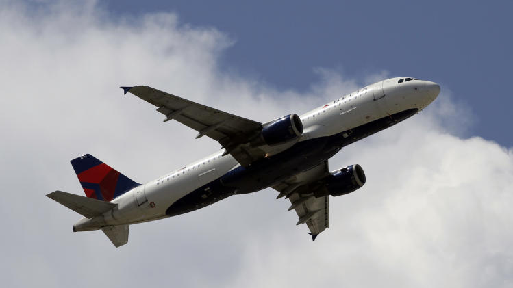 Delta posts 2Q profit on lower fuel spending