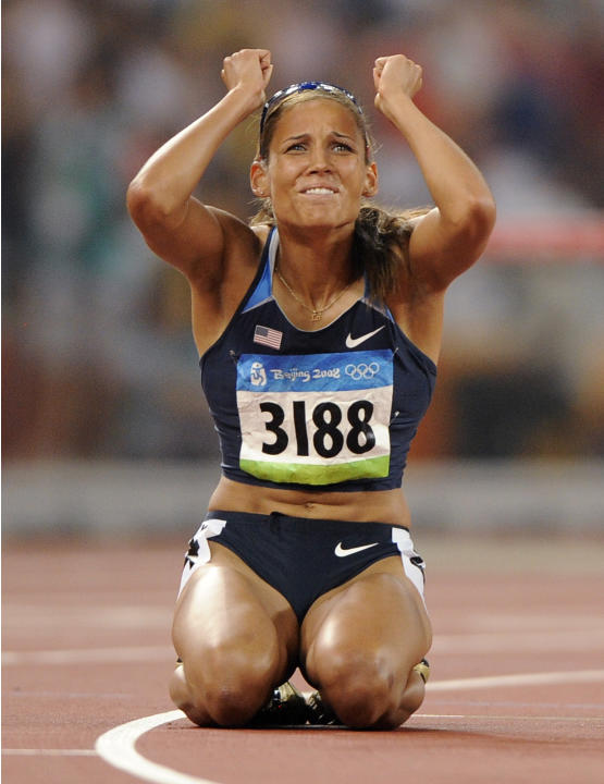 FILE - In this Aug. 19, 2008 file photo, United States' Lolo Jones reacts after the women's 100-meter hurdles final during the athletics competitions in the National Stadium  at the Beijing 20