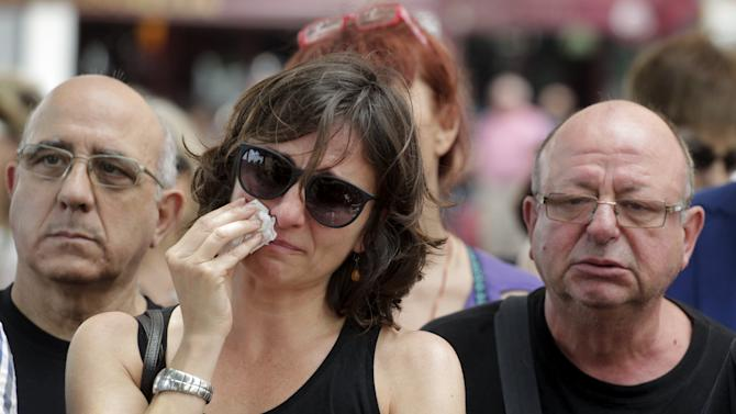 Garrote, president of the The Association of Victims of the Subway (AVM3J), cries during a ceremony in memory for those who died in a 2006 subway train accident in Valencia